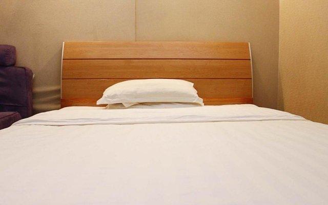 Отель Holiday Hotel Apartment Китай, Шэньчжэнь - отзывы, цены и фото номеров - забронировать отель Holiday Hotel Apartment онлайн комната для гостей