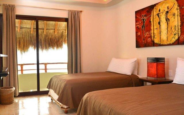 Maya Villa Condo Hotel And Beach Club Плая-дель-Кармен комната для гостей