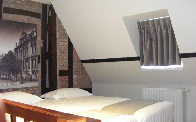 Апартаменты Amosa Apartments Rue Gerardrie 17 комната для гостей