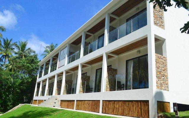 Отель Woodlawn Villas Resort вид на фасад