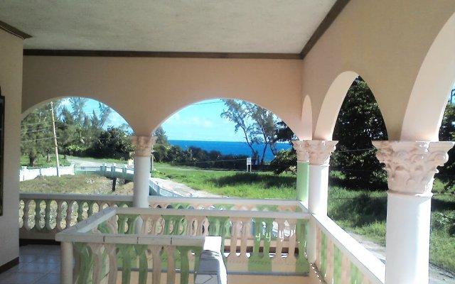 Отель Dolphin Bay Yoga Guest House Ямайка, Порт Антонио - отзывы, цены и фото номеров - забронировать отель Dolphin Bay Yoga Guest House онлайн вид на фасад