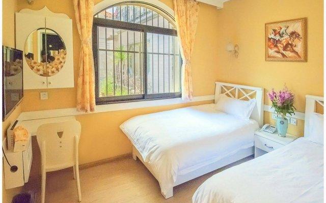 Отель Xiamen Gulangyu Sunshine Dora's House Китай, Сямынь - отзывы, цены и фото номеров - забронировать отель Xiamen Gulangyu Sunshine Dora's House онлайн комната для гостей