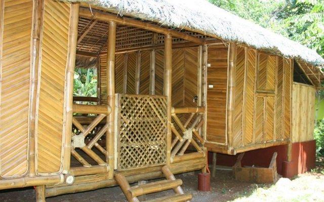 Отель Bamboo Rooms & Cottages by Dang Maria BB Филиппины, Пуэрто-Принцеса - отзывы, цены и фото номеров - забронировать отель Bamboo Rooms & Cottages by Dang Maria BB онлайн вид на фасад