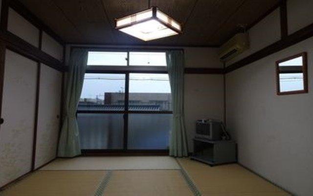 Отель Minshuku Toshi Якусима комната для гостей