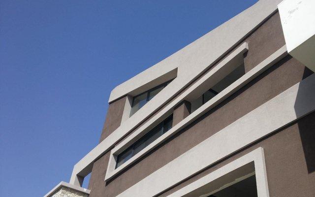 Апартаменты Oleander Boutique Apartments вид на фасад