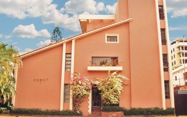 Отель Aparta Hotel Turey Доминикана, Санто Доминго - отзывы, цены и фото номеров - забронировать отель Aparta Hotel Turey онлайн вид на фасад