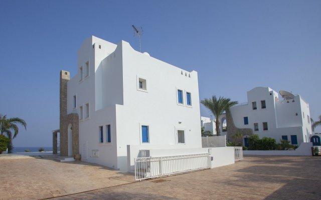 Отель Protaras Seafront Villa Mimosa Кипр, Протарас - отзывы, цены и фото номеров - забронировать отель Protaras Seafront Villa Mimosa онлайн вид на фасад