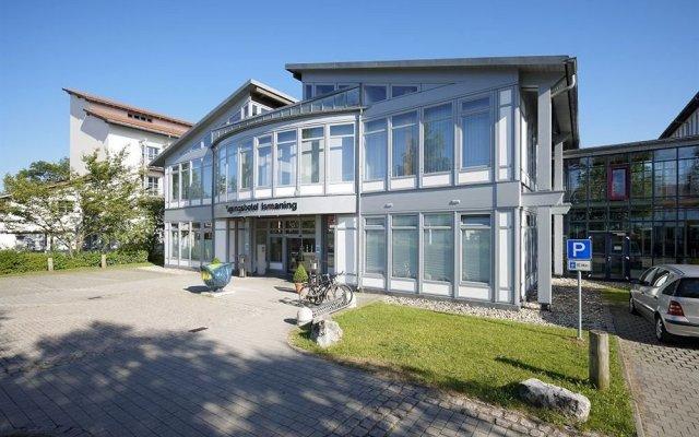 Отель Top Commundo Tagungshotel Ismaning Исманинг вид на фасад