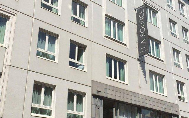 Отель Residence La Source Quartier Louise вид на фасад