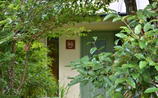 Отель Spa Greenness Минамиогуни вид на фасад