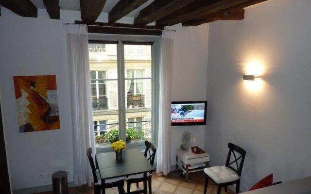 Апартаменты Moliere Studio - Heart of Paris комната для гостей