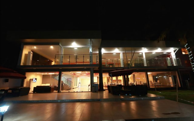 Отель Tivoli Garden Ikoyi Waterfront Нигерия, Лагос - отзывы, цены и фото номеров - забронировать отель Tivoli Garden Ikoyi Waterfront онлайн вид на фасад