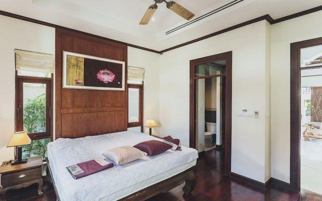 Отель Villa in Bangtao in Les Palmares Villa 8 комната для гостей