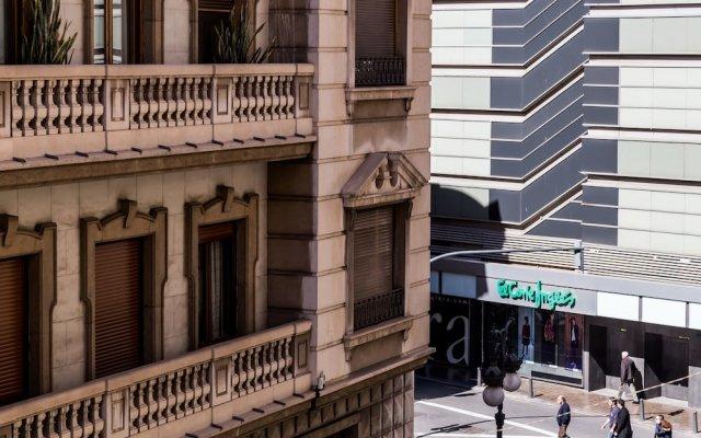 Отель Apartamento Travel Habitat Eixample вид на фасад