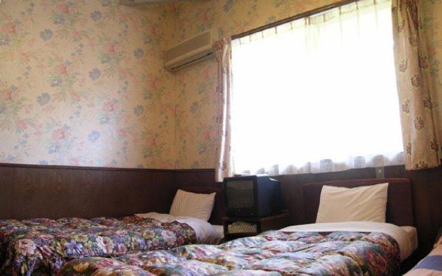 Отель Windy Umbrella Япония, Минамиогуни - отзывы, цены и фото номеров - забронировать отель Windy Umbrella онлайн комната для гостей