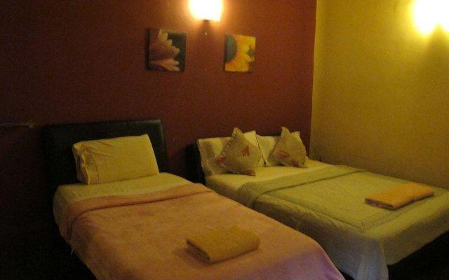 Отель Paradiso Guesthouse Малайзия, Куала-Лумпур - отзывы, цены и фото номеров - забронировать отель Paradiso Guesthouse онлайн комната для гостей