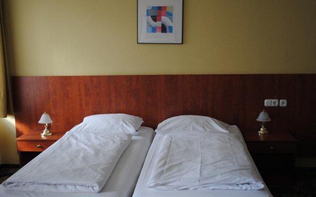 Отель Der Tannenbaum Германия, Мюнхен - отзывы, цены и фото номеров - забронировать отель Der Tannenbaum онлайн комната для гостей