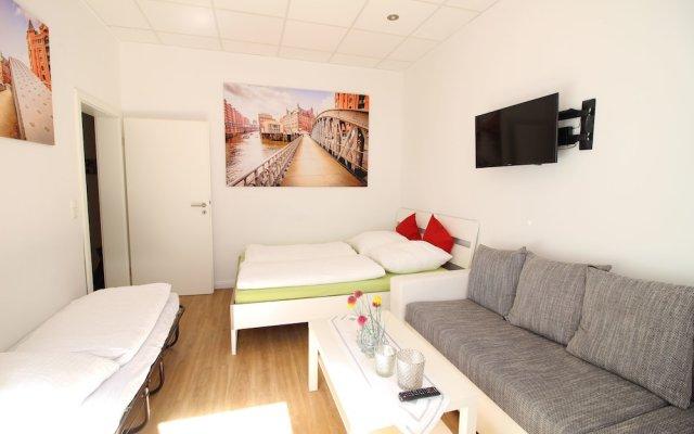 Отель Central Apartment Reeperbahn Германия, Гамбург - отзывы, цены и фото номеров - забронировать отель Central Apartment Reeperbahn онлайн комната для гостей