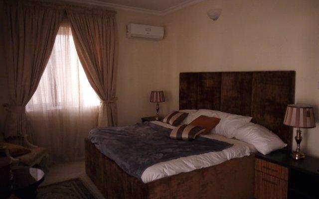 Отель Blossom Court Нигерия, Ибадан - отзывы, цены и фото номеров - забронировать отель Blossom Court онлайн комната для гостей