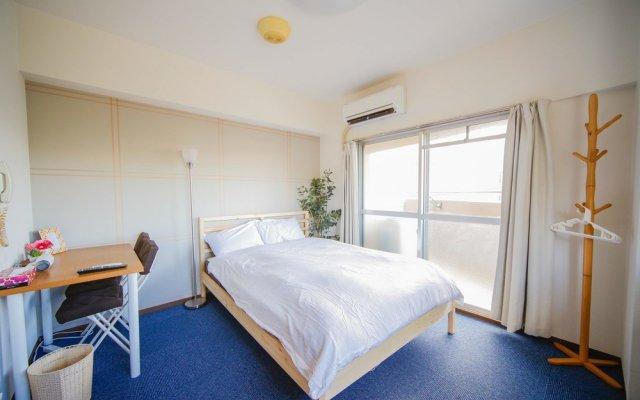 Апартаменты Hakata Apartment Хаката комната для гостей