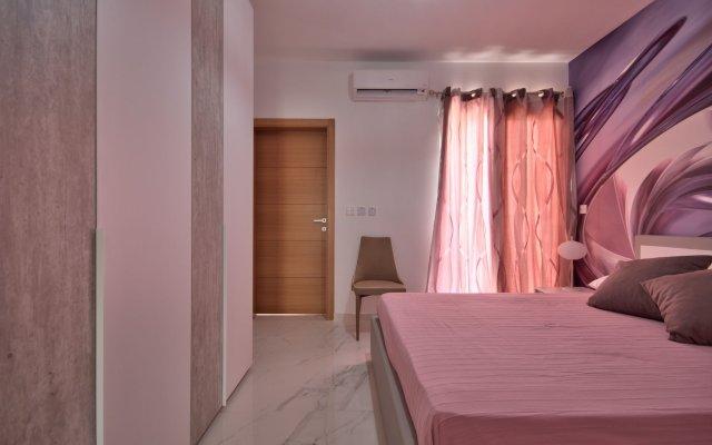 Отель First Class Apartments Calleja by G&G Мальта, Буджибба - отзывы, цены и фото номеров - забронировать отель First Class Apartments Calleja by G&G онлайн комната для гостей