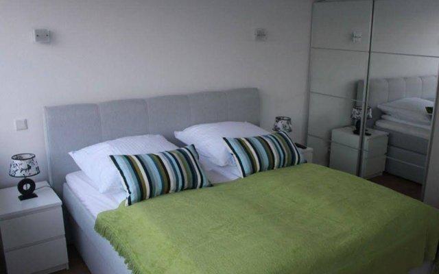 Апартаменты Mk Apartments Cranachstrasse Дюссельдорф комната для гостей