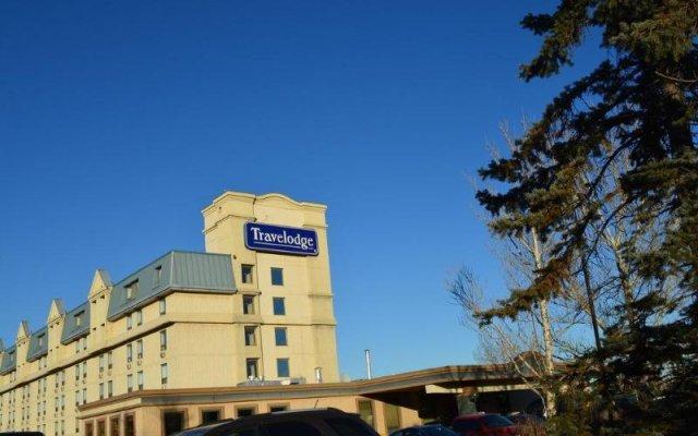 Отель Travelodge by Wyndham Calgary International Airport South Канада, Калгари - отзывы, цены и фото номеров - забронировать отель Travelodge by Wyndham Calgary International Airport South онлайн вид на фасад