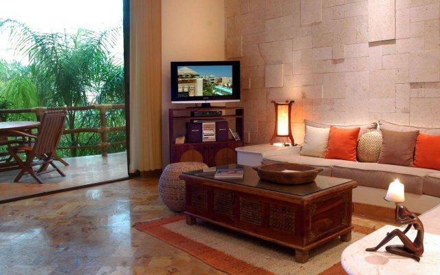 Отель Porto Playa Condo Hotel & Beachclub Мексика, Плая-дель-Кармен - отзывы, цены и фото номеров - забронировать отель Porto Playa Condo Hotel & Beachclub онлайн комната для гостей