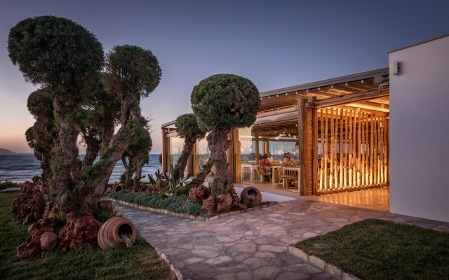 Отель Mitsis Rinela Beach Resort & Spa - All Inclusive вид на фасад
