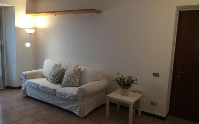 Апартаменты SoLoMoKi Apartments комната для гостей