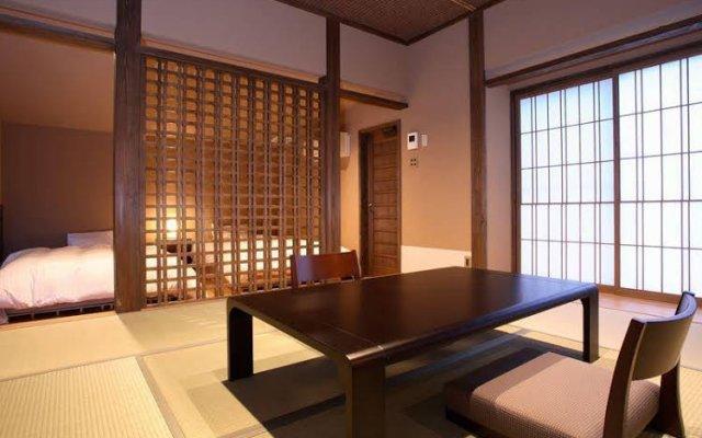 Отель Ryokan Konomama Минамиогуни комната для гостей