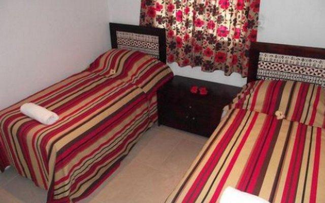 Апартаменты Hibiscus Apartments комната для гостей
