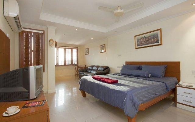 Апартаменты Argyle Apartments Pattaya Паттайя комната для гостей