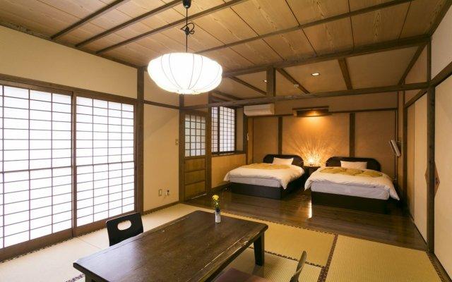 Отель Oyado Kafugetsu Минамиогуни комната для гостей
