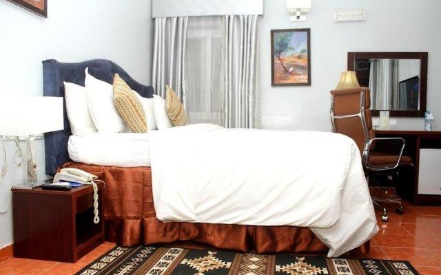 Отель Hoil Suites Калабар комната для гостей