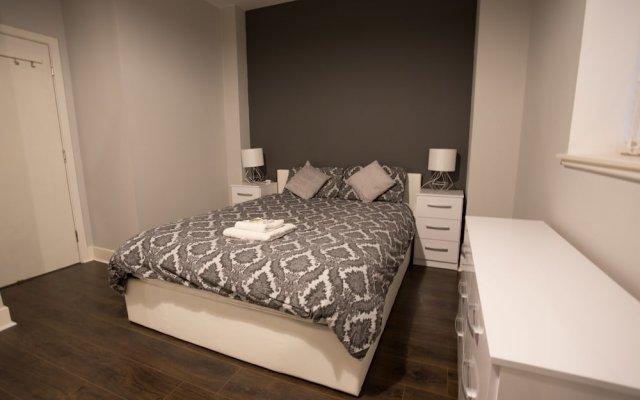 Отель StayCentral Apartments - Buchanan Street Великобритания, Глазго - отзывы, цены и фото номеров - забронировать отель StayCentral Apartments - Buchanan Street онлайн комната для гостей