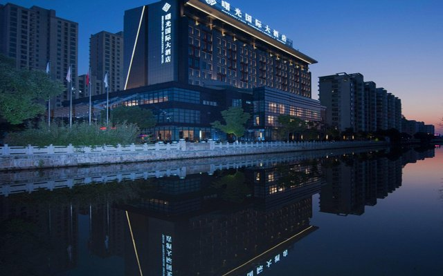 Shuguang International Hotel Kunshan вид на фасад