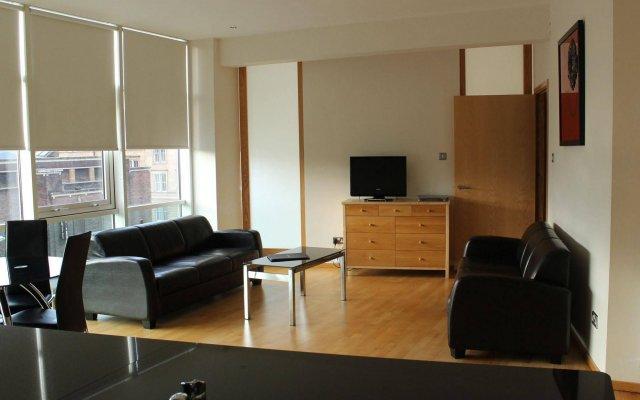 Отель Glasgow Lofts комната для гостей