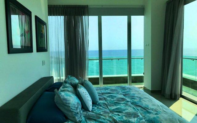 Отель Torre M1413 K by LATAM Vacation Rentals Масатлан комната для гостей