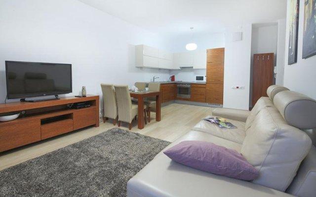 Апартаменты Pokorna Apartments комната для гостей