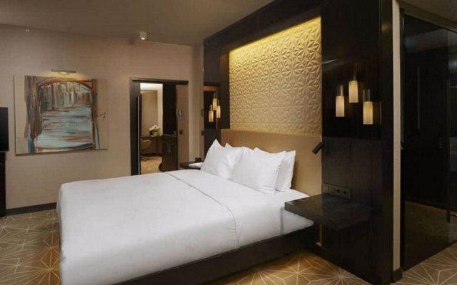 Отель Hilton Tallinn Park Таллин комната для гостей