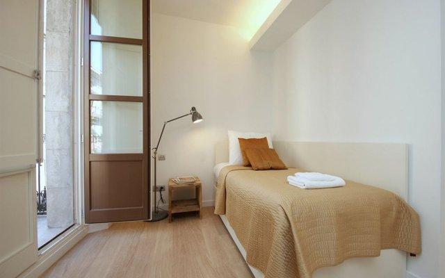 Апартаменты Ramblas Deluxe Apartments комната для гостей