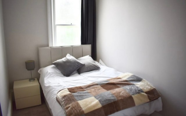 Апартаменты 2 Bedroom Apartment in Seven Dials комната для гостей