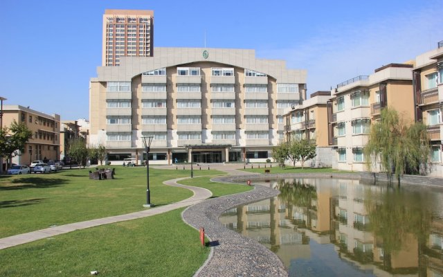 GreenPark Hotel Tianjin Тяньцзинь вид на фасад