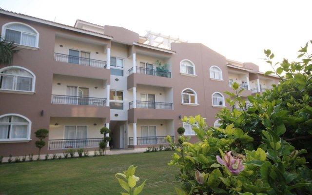 Отель Residencial Las Buganvillas Bavaro Доминикана, Пунта Кана - отзывы, цены и фото номеров - забронировать отель Residencial Las Buganvillas Bavaro онлайн вид на фасад