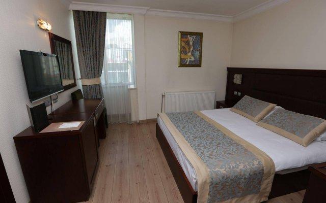Grand Saatcioglu Otel Турция, Аксарай - отзывы, цены и фото номеров - забронировать отель Grand Saatcioglu Otel онлайн комната для гостей
