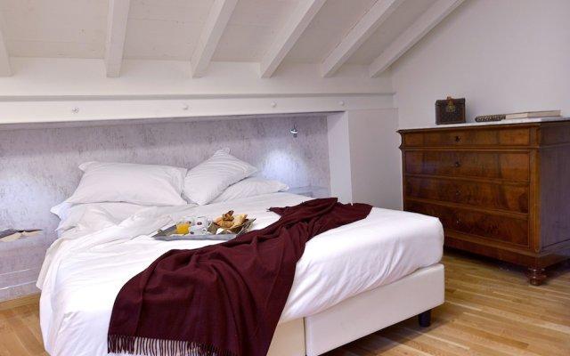 Отель Al Cappello Rosso Suite Apartments Италия, Болонья - отзывы, цены и фото номеров - забронировать отель Al Cappello Rosso Suite Apartments онлайн комната для гостей
