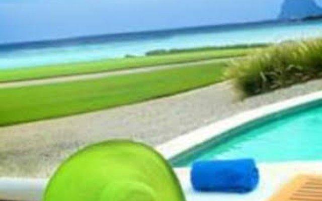 Отель Caleton Club & Villas балкон