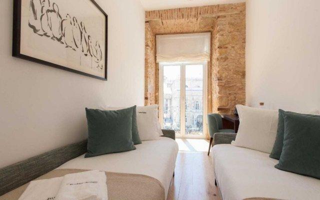 Отель Feels Like Home Rossio Prime Suites Лиссабон комната для гостей