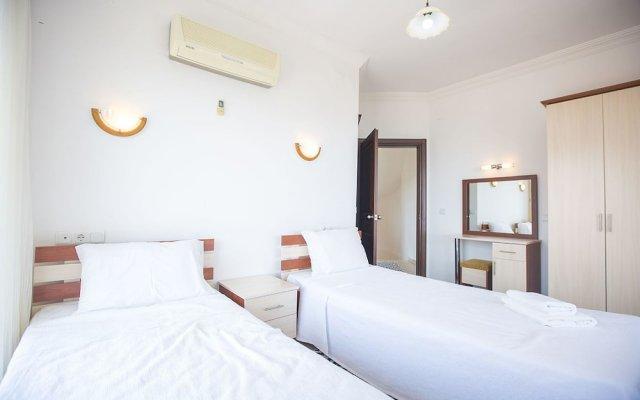 Villa Asma by Akdenizvillam Турция, Калкан - отзывы, цены и фото номеров - забронировать отель Villa Asma by Akdenizvillam онлайн комната для гостей